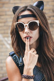 Bad sexy woman in sunglasses with leather cat ears Royalty Free Stock Photography