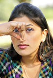 Bad smell. Indian girl with squeezing her nose stock image
