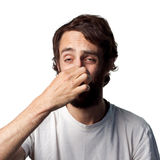 A bad smell. Man covers his nose due to a bad smell royalty free stock photos