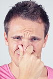 Bad smell?. Man covers nose due to bad smell Stock Images