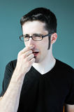 Bad smell. A young man blocks his nose after smelling something bad Stock Photo