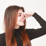 Bad smell (Body language, gestures, psychology). Close up stock photography
