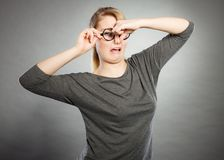 Girl pinches her nose because of stench stink. Bad smell concept. Young woman feels disgust pinches her nose with fingers because of odor stench unpleasant royalty free stock image