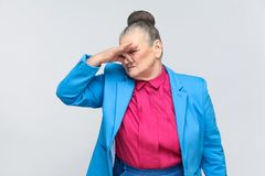 Bad smell, Emotion and feelings concept. Bad smell. Emotion and feelings concept. Portrait of handsome expressive grandmother with light blue suit and pink royalty free stock photos
