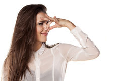Bad smell. Girl closing her nose with her fingers because of the bad smell royalty free stock images