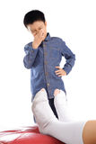 Bad smell sock. Out focus Boy feeling unhappy with bad smell white sock Royalty Free Stock Photos