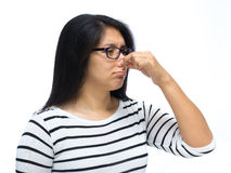 Bad smell. Woman pinching nose caused by bad smell royalty free stock photo