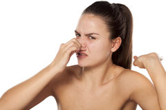 Bad smell. Young woman pinching her nose because of the smell stock photography