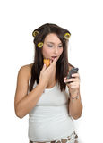 Bad sms. A beautiful lady worried reading sms on a cell phone Stock Images