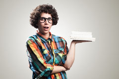 Bad student. Portrait surprise with books in hand royalty free stock photography