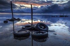Bad tires at Tanjung aru beach, Labuan. Malaysia. Wrick at Tanjung Aru beach Labuan Malaysia. with beautiful sunrise Stock Image