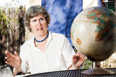 Bad traveling experience. Mature woman recalling a bad traveling experience and giving us a comical expession Royalty Free Stock Image