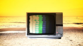 Bad TV box on the beach stock video footage