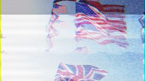 Bad TV signal British Union Jack and American flags of the United States. Waving slow motion against blue sky warm clear sky sunny day marking the friendship