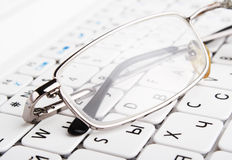 Bad vision. Glasses. On keyboard Royalty Free Stock Image