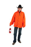 Bad weather. Man walking in bad weather with oil lamp stock image
