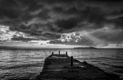 Bad weather above the Yumani dock at Lake Titicaca black and white Royalty Free Stock Photo