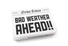 Bad weather ahead. A stack of newspapers with headline Bad Weather Ahead. on white royalty free stock image