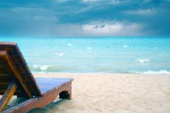 Spoiled vacation. Bad weather on the beach without people. Sunbed on the beach. Spoiled vacation stock photography