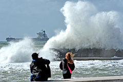 Bad weather. Big wave falls on the coast for entertaining tourists stock images