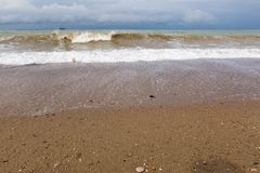 Bad weather on Black Sea coast. Sand beach in time of storm stock photography