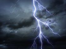 Bad weather. Bright flash and rain on dark sky stock image