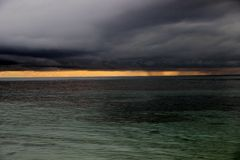 Bad weather on the Caribbean Sea. Photo storm, enacted over the Caribbean: top-heavy clouds, the sea bottom, and in the distance one can see a cloudless sky at stock image