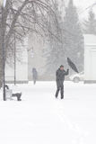 Bad weather in a city: a heavy snowfall and blizzard in winter, vertical Royalty Free Stock Photos