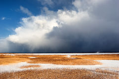 Bad weather is coming on a frozen lake in winter Royalty Free Stock Image
