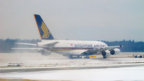 Bad weather conditions in Zurich airport. ZURICH - DECEMBER 15: Singapore Airlines A-380 taking off after deicing on December 15, 2010 in Zurich, Switzerland Royalty Free Stock Photography