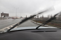 Bad weather driving car. Bad weather driving - wipers working, rainy day Stock Photos