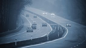 Bad weather driving - foggy hazy country road. Motorway - road traffic. Winter time.  royalty free stock photography