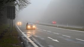 Bad weather driving - foggy hazy country road. Motorway - road traffic. Winter time.  royalty free stock photos