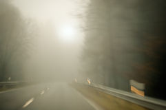 Bad weather driving - foggy road Stock Photography