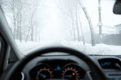 Bad weather driving in winter. Fog on the road Royalty Free Stock Photography