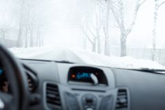 Bad weather driving in winter. Fog on the road Stock Images