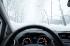 Bad weather driving in winter. Fog on the road Royalty Free Stock Image