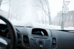 Bad weather driving in winter. Fog on the road Royalty Free Stock Photos