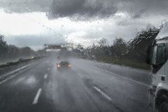 Bad weather on the highway. Difficult driving with high risk of road accidents due to bad weather on the highway in Italy stock photography