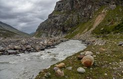 Bad weather in Mountain region. River flowing through mountainous terrain in Spiti Valley, Himachal Pradesh. India royalty free stock photography