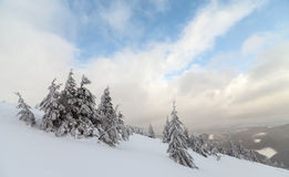 Bad weather in the mountains. Winter landscape. Cloudy evening with storm clouds. Carpathians, Ukraine, Europe Stock Photo