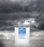 Bad weather. Opened door from bad weather to good royalty free stock photography