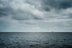 Bad weather over ocean. Bad, stormy weather over ocean with ship at horizon royalty free stock photography