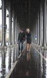 Bad weather in Paris. Couple on the bridge Bir-Hakeim at rainy weather royalty free stock images