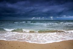 Bad weather at sea. Stormy sky over the sea deserted beach. Bad weather at sea. Off Season stock photography