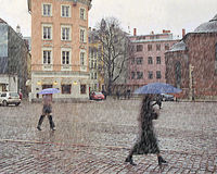 Bad weather. Sleet in the city late autumn. Stock Photos