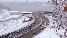 Bad Weather Snow Storm Traffic of cars on a highway. Traffic of cars on a highway at winter frosty morning in the city. Urban cityscape stock video footage
