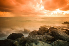 Bad weather. Stormy weather on the stone coast during a fiery or Royalty Free Stock Photo