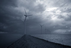 Bad weather and windmills stock images