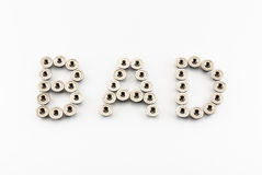 BAD Word Created by Stainless Steel Hex Flange Nuts Royalty Free Stock Images